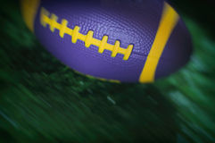 Close up of moving mini American football on the green grass Royalty Free Stock Images