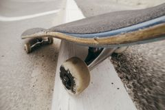 Close up of moving skateboard on city road marking Stock Photography