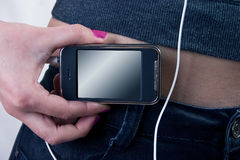 Close-up MP3 Player. Close-up of woman body and music player in her pocket stock photos