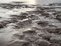 Water drenched mud flats royalty free stock images