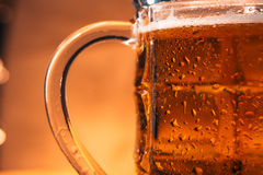 Close-up mug of light beer on a blurred background Stock Image