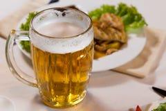 Free Close Up Mug Of Beer Beside Main Dish Royalty Free Stock Photography - 45397357
