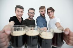 Close up.mugs of beer in the hands of the fans. Royalty Free Stock Photo