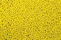 Close up multi colored beads heap stock photos