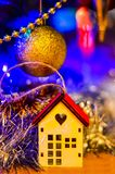 The close-up of the multi-colored Christmas toys in the form of a house, owl, horse on the Christmas tree in the new 2019 year. stock photography