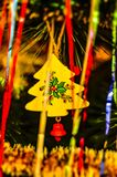 The close-up of the multi-colored Christmas toys in the form of a house, owl, horse on the Christmas tree in the new 2019 year. stock images