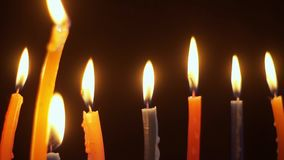 Close-up of multi-colored lit candles stock footage