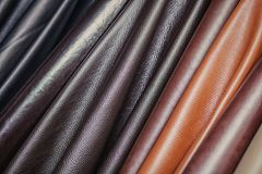 Pattern made of genuine leather. A close-up of multi-colored natural leather: black and different browns. Pattern made of genuine leather Royalty Free Stock Image