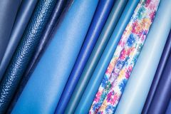 Pattern made of genuine leather. A close-up of multi-colored natural leather: blue and different blue backgrounds. Pattern made of genuine leather Stock Images