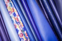 Pattern made of genuine leather. A close-up of multi-colored natural leather: blue and different blue backgrounds. Pattern made of genuine leather Stock Photo