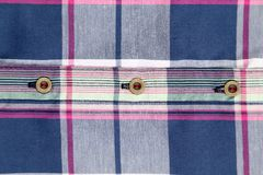 Close up of multi-colored plaid shirt. Stock Images