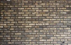 close-up Multi-colorido da parede de tijolo, textura, superfície desigual, fundo fotografia de stock royalty free