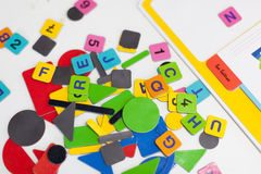 Close up of multi-coloured alphabet puzzle pieces Royalty Free Stock Photography