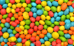 Close-up of multicolor candies texture background. Rainbow colorful candy coated chocolate pieces in a bowl. Colorful pattern Royalty Free Stock Photography