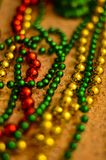 Close-up of multicolored Christmas beads for decorating the Christmas tree with a soft blurred background. royalty free stock photos