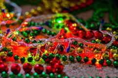 Close-up of multicolored Christmas beads for decorating the Christmas tree with a soft blurred background. stock photo