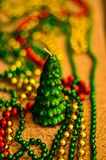 Close-up of multicolored Christmas beads for decorating the Christmas tree with a soft blurred background. stock photography