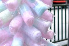 Close up a multicolored of cotton candy in a plastic packaging. A merchant selling on a street in the outdoor festival royalty free stock images