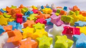 Close-up of multicolored star shapes on gray background Stock Photo
