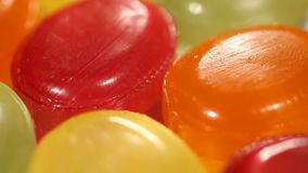 Close-up of multicolored sweet hard candies, childhood dream, happy vivid life. Stock footage stock video footage