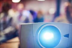 Close-up multimedia projector with blurred people background. Close-up multimedia projector with blurred people background royalty free stock photos