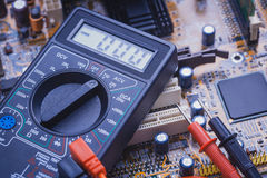 Close-up of multimeter on PCB plate Royalty Free Stock Image