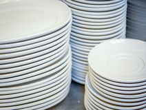 Close up of multiple stacks of white plates Stock Photography
