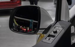 The close up of Multivan indoor contron panel with rear side vie. The close up of Multi van indoor contron panel with rear side view mirror in the background Stock Photos