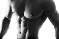 Close up of muscular bodybuilder guy doing exercises with weights isolated on white. Monochrome Stock Photo