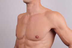 Close up of muscular male torso and chest hair removal. Male Waxing Royalty Free Stock Photography