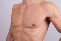 Close up of muscular male torso and chest hair removal. Male Waxing Royalty Free Stock Images
