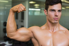 Close-up of muscular man flexing muscles Royalty Free Stock Photo