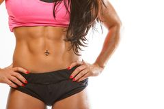 Close up muscular woman`s stomach. stock photo