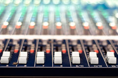Close-up of music controls buttons of studio mixer Royalty Free Stock Image