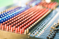 Close-up of music controls buttons of studio mixer Royalty Free Stock Photo