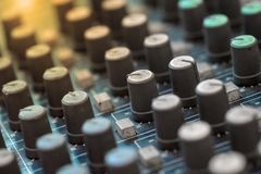 Sound technician audio mixer equalizer control for background. Close up of music mixer equalizer console for mixer control sound device. Sound technician audio stock photo