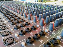 Studio, Audio Equipment, Radio, Lighting Equipment, Equipment. Close up of music mixer equalizer console for mixer control sound device. Sound technician audio royalty free stock photography
