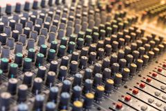 Sound technician audio mixer equalizer control for background. Close up of music mixer equalizer console for mixer control sound device. Sound technician audio stock image