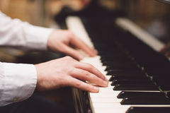 Close-up of a music performer's hand playing the piano. Close-up of a music performer's hand playing piano Royalty Free Stock Photos
