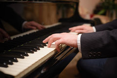 Close-up of a music performer's hand playing the piano. Close-up of a music performer's hand playing Royalty Free Stock Image