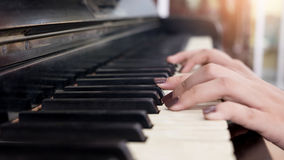 Close-up of a music performer& x27;s hand playing the piano. Close-up of a music performer& x27;s hand playing piano Royalty Free Stock Photography