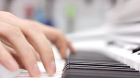 Close-up of a music performer`s hand playing the piano stock footage