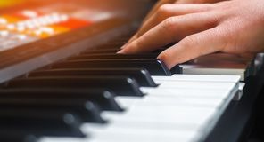 Close-up of a music performer`s hand playing the piano, man`s ha. Nd, classical music, keyboard, synthesizer, pianist hobby Stock Photography