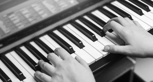 Close-up of a music performer`s hand playing the piano, man`s hand, classical music, keyboard, synthesizer, pianist Royalty Free Stock Photo