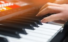 Close-up of a music performer`s hand playing the piano, man`s hand, classical music, keyboard, synthesizer, pianist.  Royalty Free Stock Photography