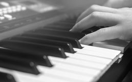 Close-up of a music performer`s hand playing the piano, man`s ha. Nd, classical music, keyboard, synthesizer, pianist Stock Images