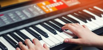 Close-up of a music performer`s hand playing the piano, man`s ha. Nd, classical music, keyboard, synthesizer, pianist. hobby Stock Photo