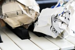 Close-up music score on piano keyboard, piece of paper. Object Royalty Free Stock Photos