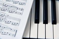 Close-up music score on piano keyboard Royalty Free Stock Photography