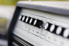 Close up of music tuner black buttons. Professional instrument for adjust sound and volume stock photography